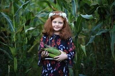 child in cornfield