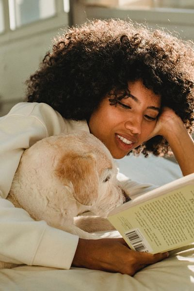 Mom reads with dog